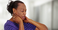An older black woman with bad neck pain Stock Footage