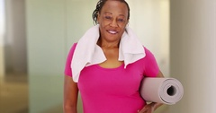 An elderly African American woman poses for a portrait after her workout Stock Footage