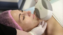 Young woman doing cosmetology laser therapy Stock Footage