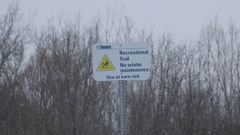 Recreational winter trail sign. Snow falling. Toronto, Canada. Stock Footage