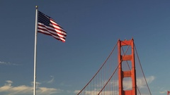 US American Flag Waving Golden Gate Bridge National Recreation Area Stock Footage