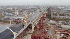 Aerial view of big modern viaduct or bridge above buildings and cityscape Stock Footage