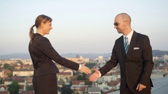 CLOSE UP: Businessman and woman from corporate company conclude an agreement Stock Footage