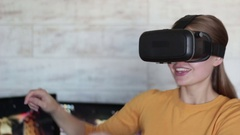 Young beautiful woman using vr headset Stock Footage