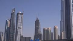 4K Dubai unique skyline business development skyscrapers in blue sky background Stock Footage