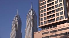 4K twin towers buildings in Dubai skyline skyscrapers urban scene banking center Stock Footage