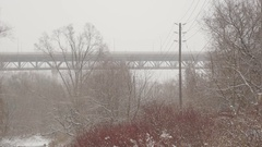 Don Valley with Leaside bridge and TTC bus. Snowstorm in Toronto. Stock Footage