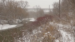 Don Valley snowstorm. Bridge and buses in background. Toronto. Stock Footage