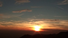 Fiery sunset from mountain pick with thin glazes in the sky evening. Stock Footage