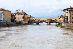 Water of Arno river and Ponte Vecchio in autumn Stock Photos