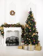 Beautiful holiday decorated room with fireplace and Christmas tree Stock Photos