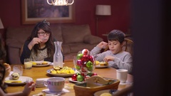 A family eating dinner at the kitchen table Stock Footage