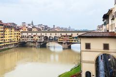 Ponte Vecchio and Arno river in autumn rain Stock Photos