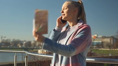 Lost girl holding map and looks upset while talking on cellphone, steadycam shot Stock Footage