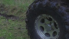 Four wheeler send dirts into the air Stock Footage