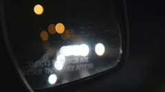 Headlights in passenger mirror. Driving at night. Stock Footage
