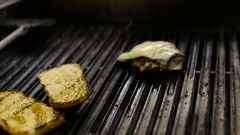 Chef frying chicken and bread for sandwiches on the barbecue Stock Footage