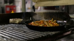Cooking vegetables and chicken breast fillet in pan Stock Footage