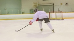 Young hockey player shoots the puck Stock Footage