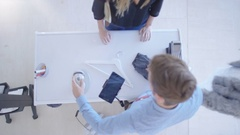 4K Overhead view of customer making payment with smartphone in clothing store Stock Footage