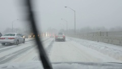 Driving across Leaside bridge in snowstorm. Toronto, Canada. Stock Footage