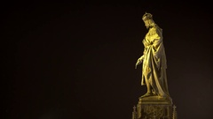Statue of King Charles IV. on Charles Bridge at night, Prague, Czech Republic Stock Footage