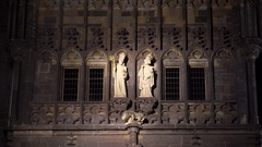 Religious statues on Charles Bridge tower at night, Prague, Czech Republic Stock Footage