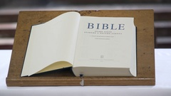 Bible holy book open on page one Stock Footage