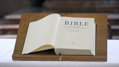 Open Bible holy book on page one Stock Footage