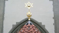 Gold Jewish star of David on synagogue, close up, Prague, Czech Republic Stock Footage