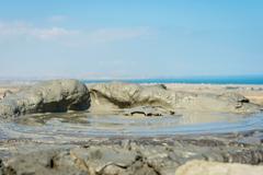 Mud volcano erupting mud, Gobustan, Azerbaijan Stock Photos