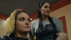 Hairdresser explains the next process in the hair coloring Stock Footage