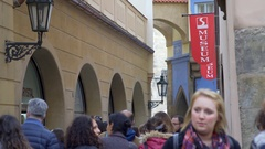 Museum sign, busy street with many people, Prague, Czech Republic Stock Footage