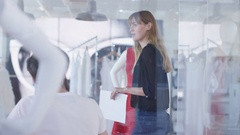 4K Fashion designers working for large retailer brainstorming & discussing ideas Stock Footage