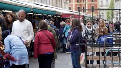 Tourists shop for souvenirs at tourist market shops, Prague old city, Czech R. Stock Footage