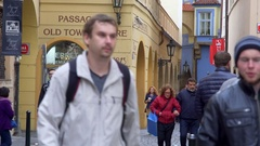 People walk in busy cobble stone alley street, old city Prague, Czech R. Stock Footage