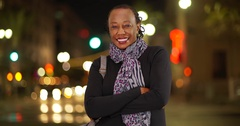 A portrait of an older African American woman laughing in the cold weather on a Stock Footage