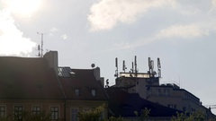 Cellphone network antennas on a roof in the city, Prague Stock Footage