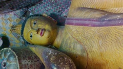 Panning video of lot Buddhas statues in sacred Golden Temple.  Sri Lanka Stock Footage