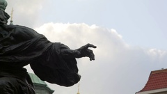 Statue dramatically points finger, Jan Hus Memorial, Prague old town square Stock Footage