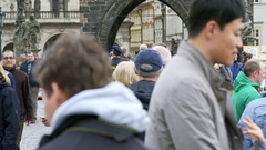 Police and soldiers patrol Charles Bridge, busy tourist crowd, Prague, Czech R. Stock Footage