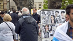 Caricature artist at busy Charles Bridge, tourist crowd, Prague Stock Footage