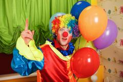 Funny clown with a bunch of colorful air balloons Kuvituskuvat