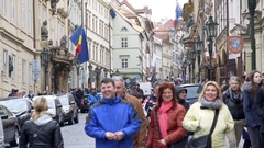 Crowded busy street with people, Romanian Italian Embassy, Prague Stock Footage