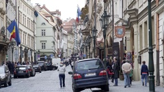 Crowded cobble stone street with people, Romanian Italian Embassy, Prague Stock Footage