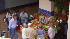 CUSTOMERS FRUIT VEGETABLE STALL MARKET MADEIRA Stock Footage