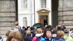 Crowd of people tourists walk into Prague Castle grounds, Czech Republic Stock Footage