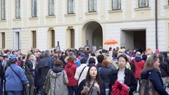 Tourists crowd walks into Royal Castle grounds, Prague, Czech Republic Stock Footage