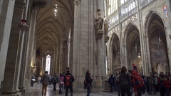 Many tourists walk inside Saint Vitus Cathedral, Prague Castle, Czech Republic Stock Footage