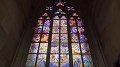 Stained glass window art, Saint Vitus Cathedral, low angle, Prague, Czech R. Stock Footage